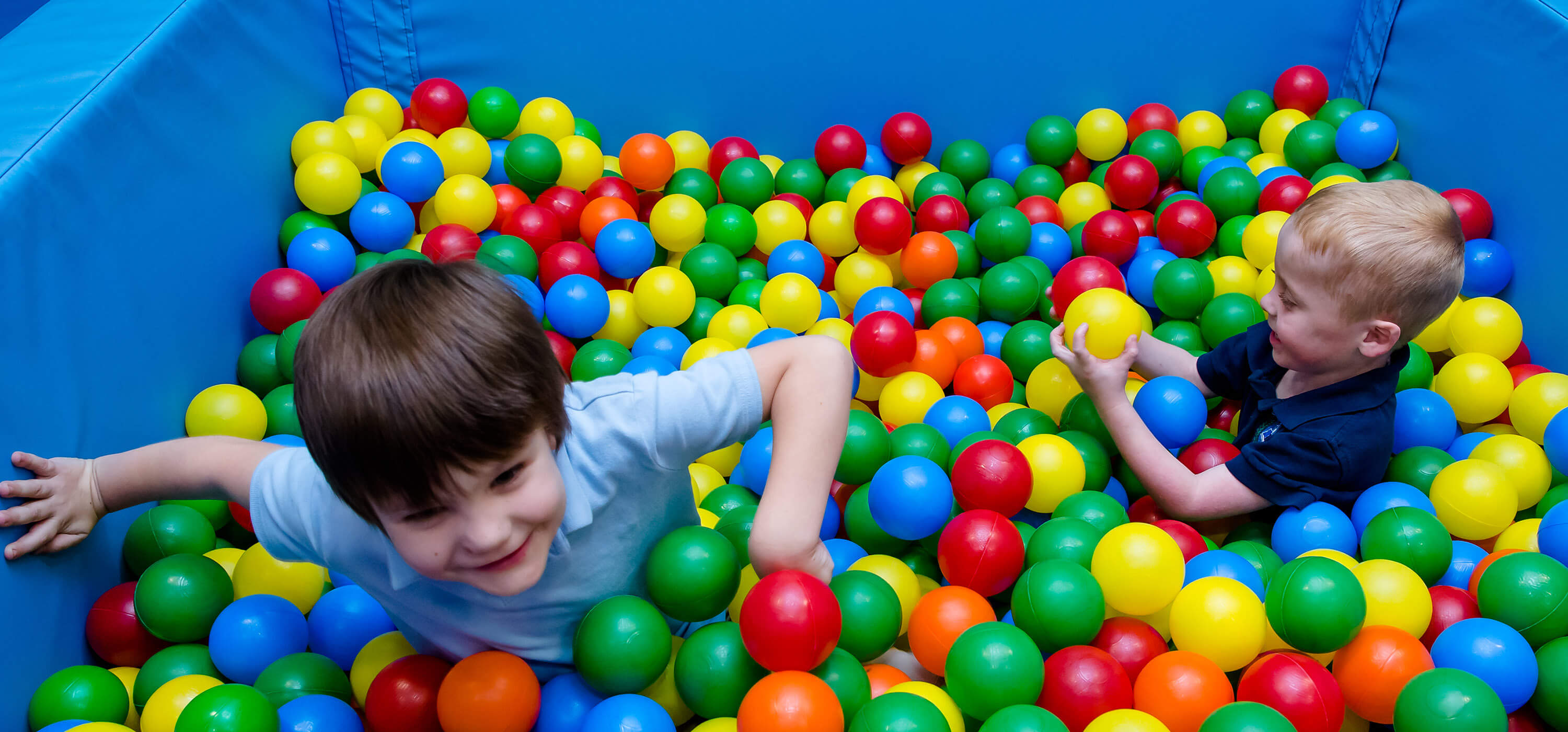 Two children playing in the ball pit at the Park in the Center for Autism