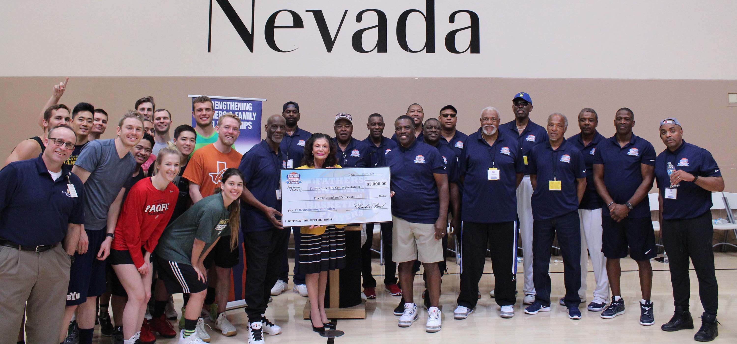 The fathers of NBA greats on the basketball court with the Touro Nevada team.