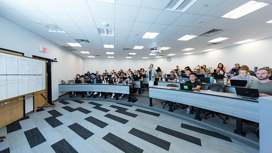 A lecture hall filled with students.