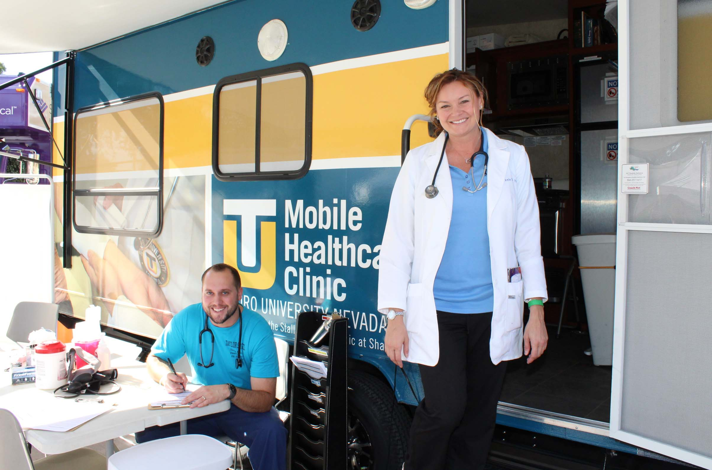 Students from the Physician Assistant Studies program outside of the mobile healthcare clinic.