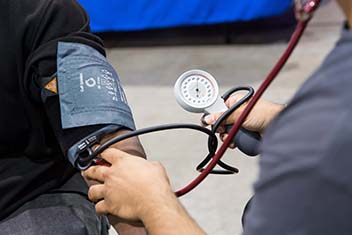 A stethoscope on an arm.