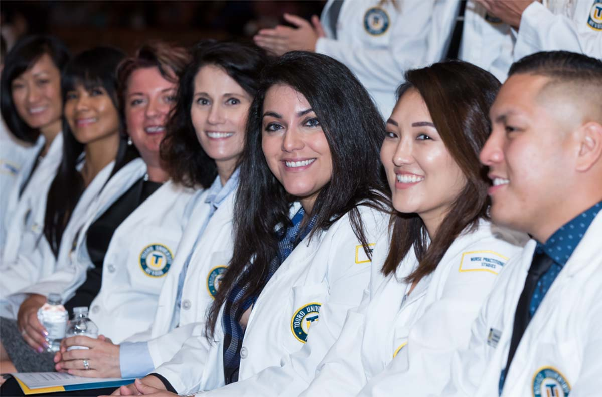 Students at a white coat ceremony.